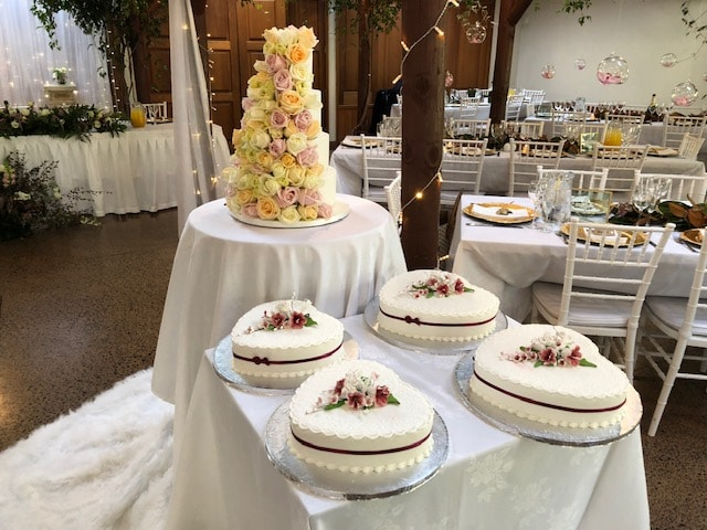 5 beloved wedding cake traditions and their origins